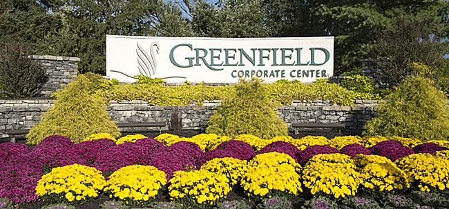 Greenfield corporate center sign